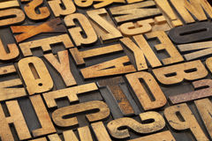 Antique wood alphabet abstract Stock Image