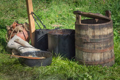 Antique wood bucket on green grass. Antique wood bucket and kitchen accessories on greed grass Stock Images