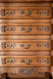 Antique wood carved chest of drawers Stock Photo