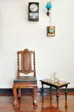 Antique wood chair and tea set on wooden floor Royalty Free Stock Photo