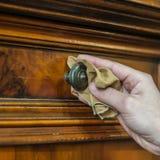 Antique wood furniture restoration. Hand restoring a wood furniture Stock Images