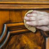 Antique wood furniture restoration. Hand restoring a wood furniture Stock Photography