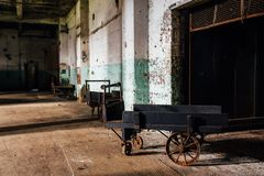 Antique Wood Hand Cart With Cast Iron Wheels - Abandoned Glass Factory Stock Photos