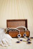 Antique wood jewellery box and gloves Stock Images