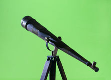 Antique Wood Telescope on a Tripod. Antique wood telescope mounted on a tripod isolated on green Stock Image