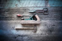 Antique Wood Working Tools with Cross Process Filter. Overhead image of collection of antique, weathered vintage tools, including hammer, awl, tin snips and Royalty Free Stock Image