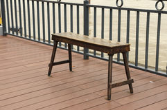 Antique wooden bench chill out on riverside. Stock Images