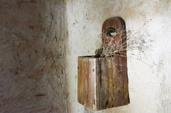 Antique  wooden box for salt. Sugar  with wild plant, hung on the wall . Lithuania Stock Photography