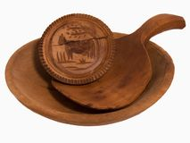 Antique Wooden Butter Stamp, Scoop and Bowl. Antique wooden butter stamp, scoop or spoon, and bowl. Stamp has a cow carved into it Royalty Free Stock Photos