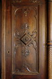Antique wooden carved door. A picture of a wooden carved door of an antique closet Royalty Free Stock Images