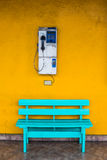Antique wooden chair blue with cell wall with a yellow. Stock Photos