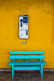 Antique wooden chair blue with cell wall with a yellow background. Royalty Free Stock Images