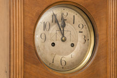 Antique wooden clock deadline 5 to 12 Stock Image