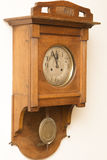 Antique wooden clock deadline 5 to 12 Stock Photography