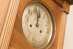 Antique wooden clock deadline 5 to 12 Stock Images