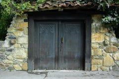 Antique wooden closed door, historic concept stock photo