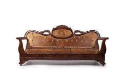 Antique Wooden Couch. A beautiful antique wooden couch is  on a white background Royalty Free Stock Photography