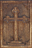 Antique wooden cross in warm tone. Greek Royalty Free Stock Photography