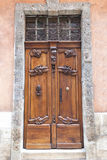 Antique wooden door with carvings Royalty Free Stock Photos