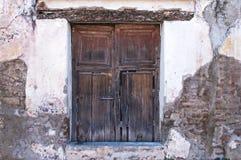 Antique wooden door in exposed wall Stock Photography