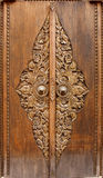 Antique wooden door with floral carvings Stock Image