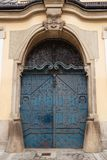 Antique wooden door with forging Royalty Free Stock Images