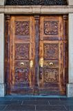 Antique wooden door with handle and decorations royalty free stock images