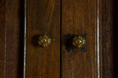 Antique wooden door handles. Constructed from engraved brass stock photography