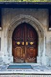 Ancient wooden door with knocker and closing mechanism Royalty Free Stock Photos