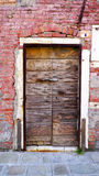 Antique wooden door and old brick wall Royalty Free Stock Images
