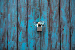 Antique wooden door painted in blue stock photo