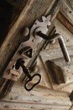 Antique wooden doors of the ancient door lock (fragment) Royalty Free Stock Images