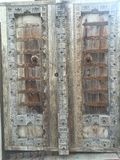 Antique wooden doors with carved detail Royalty Free Stock Photo