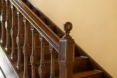 Wooden handrail and staircase, balusters. selected focus. Antique wooden handrail and staircase, balusters. selected focus on handrail royalty free stock photos