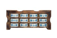 Antique wooden kitchen cupboard  with porcelain boxes for spices Stock Image
