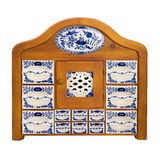 Antique wooden kitchen cupboard  with porcelain boxes for spices Royalty Free Stock Image