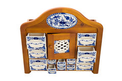 Antique wooden kitchen cupboard  with porcelain boxes for spices Stock Photo