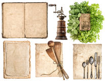 Antique wooden kitchen utensils, old cookbook, used paper and he Royalty Free Stock Image