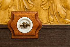 Antique wooden light switch Stock Photos