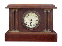 Antique wooden mantel clock isolated. Stock Image