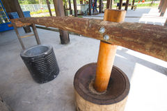 Antique wooden mortar for grinding rice Stock Images