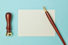 Antique wooden pen to ink and paper. Stock Photo