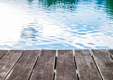 Antique wooden pier on the lake with sunlight effects. Antique wooden pier on the lake, with sunlight effects Royalty Free Stock Images