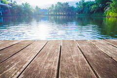 Antique wooden pier on the lake with sunlight effects. Antique wooden pier on the lake, with sunlight effects Stock Images