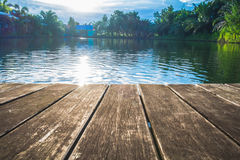 Antique wooden pier on the lake with sunlight effects. Antique wooden pier on the lake, with sunlight effects Stock Photo