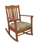 Antique wooden rocking chair isolated. Antique oak mission style wooden rocking chair with cushion. Isolated on white stock images