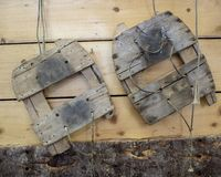 Antique wooden snowshoes. Hanging on a shed wall stock images