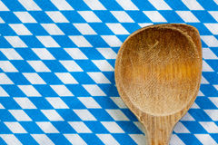 Antique wooden spoon for cooking with blue white background Stock Photography