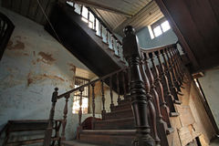 Antique wooden stairs interior. Inside old building Stock Photos