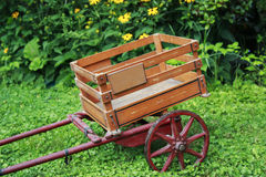 Antique Wooden Trolley with Red Wheels. Antique Wooden Trolley with Red Metal Wheels Royalty Free Stock Photography